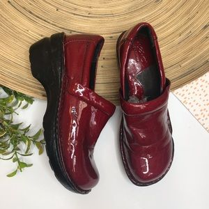 Born red patent nurse clogs